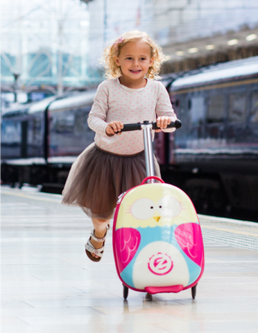 Girl using pink Zinc Flyte scooter