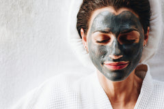 woman at the spa with facial mask on