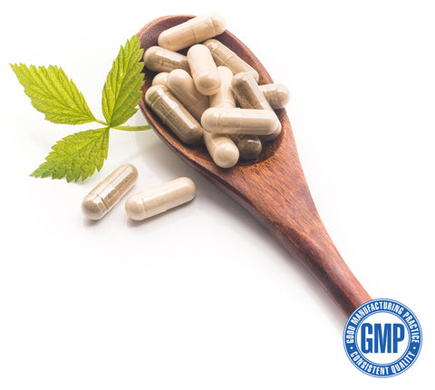 A wooden spoon with supplement pills