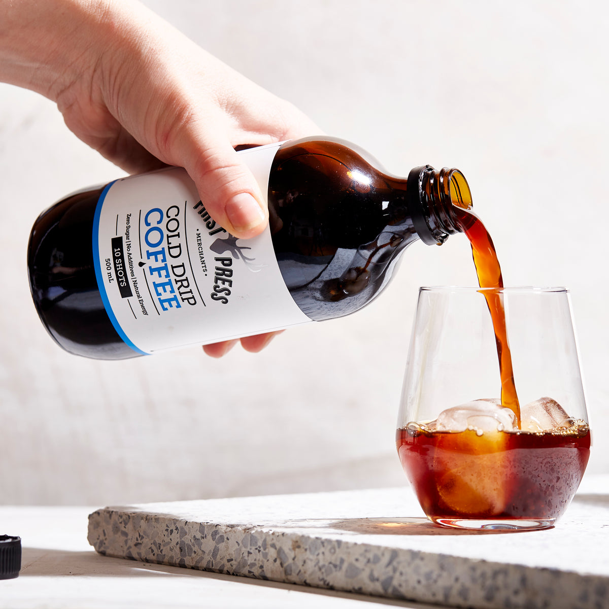 First Press Coffee - Big Boy 500ml Original Cold Drip Coffee - A bottle pouring into Glass over ice