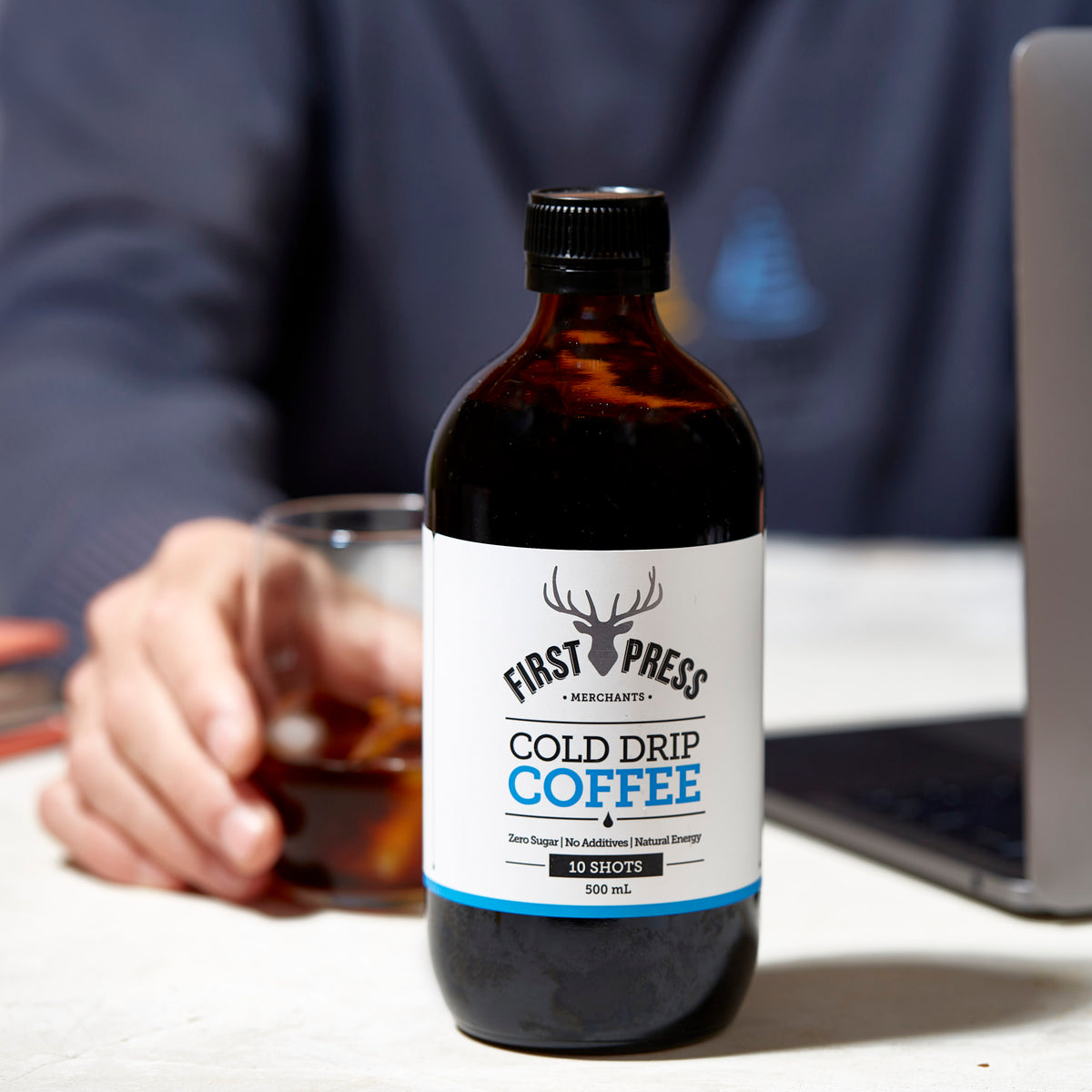 First Press Coffee - Big Boy 500m Cold Drip Coffee - Bottle sitting on desk next to laptop
