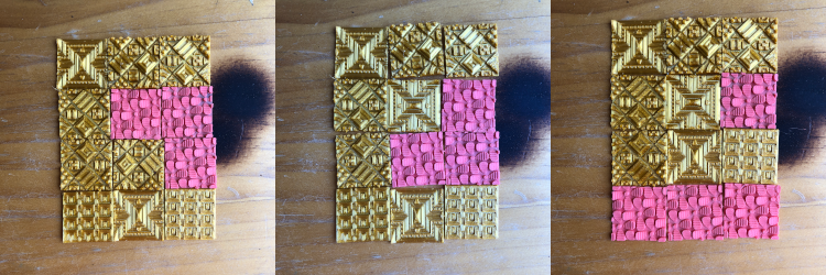 Various arrangements of gold and coral square 3D stickers from Styklet.