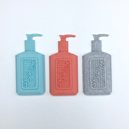 Three 3D stickers depicting full-size bottles of hand sanitizer in turquoise, coral, and gray.