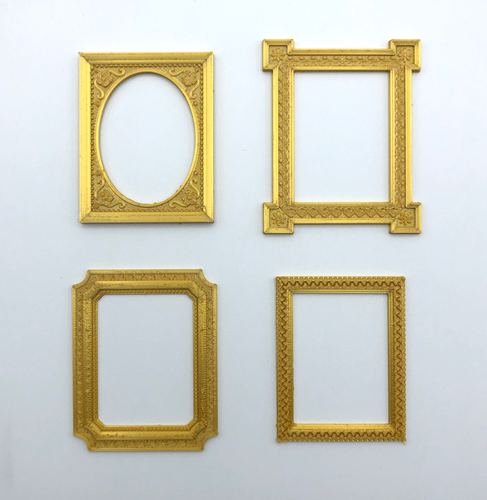 A set of four different frame stickers 3D printed in gold, from Styklet.