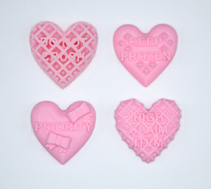 Candy heart stickers from Styklet with the text Do Not Crush, Keep Frozen, Priority, and High Claim Item in pink.