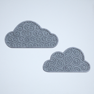 A pair of cloud stickers with a 3D spiral texture, 3D printed in gray.