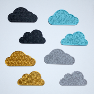 8 cloud stickers from Styklet with a 3D spiral texture, shown in black, gold, turquoise blue, and gray.