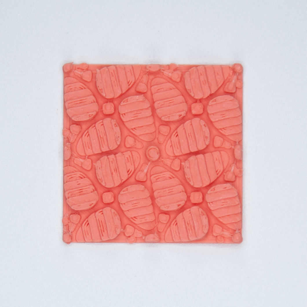 A floral patterned 3D sticker from Styklet in coral.