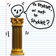 Load image into Gallery viewer, A gold Corinthian column sticker from Styklet with a skull doodle on paper.