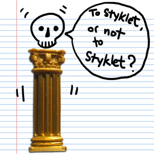 A gold Corinthian column sticker from Styklet with a skull doodle on paper.