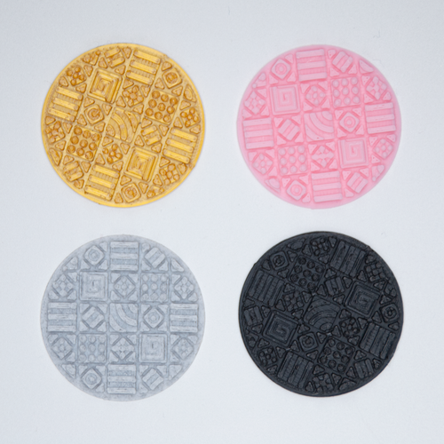 Four cosmati circle textured stickers from Styklet in gold, pink, gray, and black.