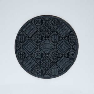 A circular Cosmati tile texture sticker from Styklet in black.