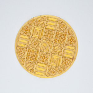 A circular Cosmati tile texture sticker from Styklet in gold.