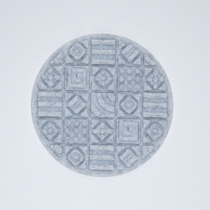 A cosmati tile texture circle sticker from Styklet in gray.
