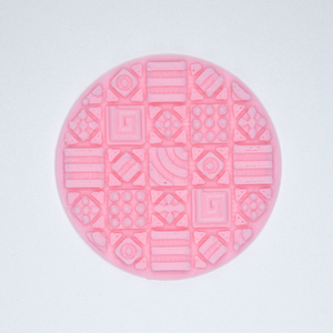 A circular Cosmati tile texture sticker from Styklet in pink.