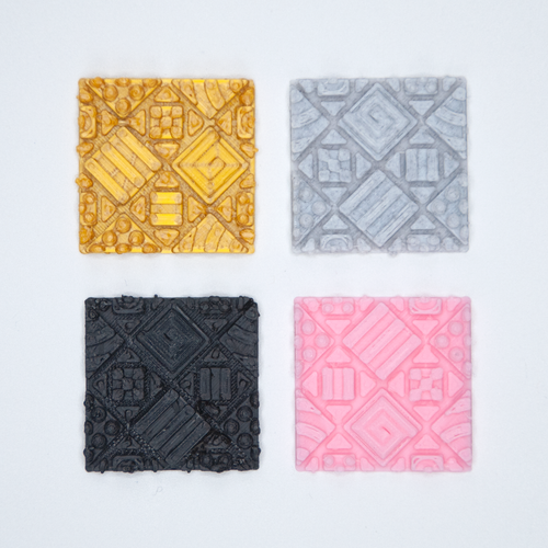 Four tileable Cosmati textured stickers from Styklet, in gold, gray, black, and pink.