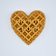 "Load image into Gallery viewer, Gold Candy Heart sticker from Styklet with the text ""Do Not Crush."""