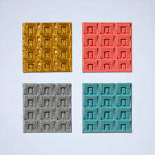 Load image into Gallery viewer, A set of four square 3D texture tile stickers, featuring a rectangular geometric pattern, in gold, coral, gray, and turquoise.