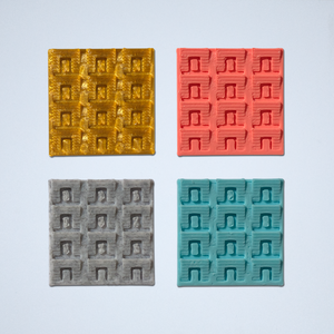 A set of four square 3D texture tile stickers, featuring a rectangular geometric pattern, in gold, coral, gray, and turquoise.