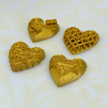 Load image into Gallery viewer, Set of four gold candy heart stickers from Styklet, shown at an angle.