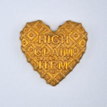 "Load image into Gallery viewer, Gold Candy Heart sticker from Styklet with the text ""High Claim Item."""