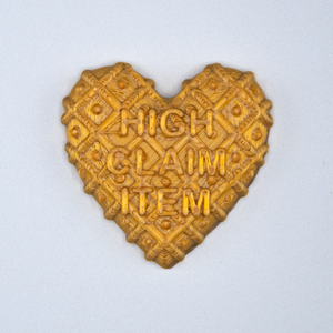 "Gold Candy Heart sticker from Styklet with the text ""High Claim Item."""