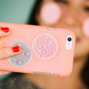 A pink cosmati texture sticker shown on a pink phone case.