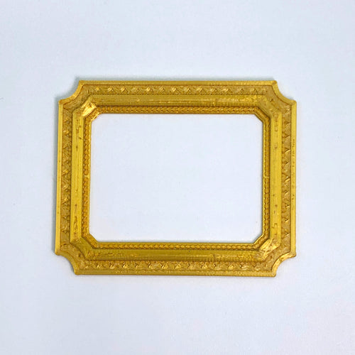 A gold 3D sticker of a Louvre frame from Styklet.
