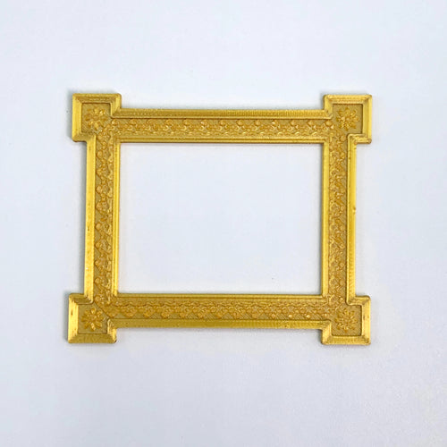 An ornamental, textured picture frame sticker from Styklet in gold.