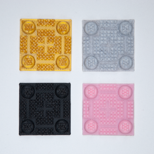Four tileable industrial grip stickers in gold, gray, black, and pink.
