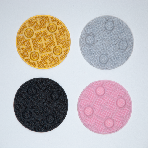 Four circular 3D stickers with an industrial grip texture, in gold, grey, black, and pink.