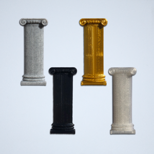 Four Ionic column 3D stickers from Styklet, in grey, gold, black, and white.