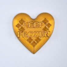 "Load image into Gallery viewer, Gold Candy Heart sticker from Styklet with the text ""Keep Frozen."""