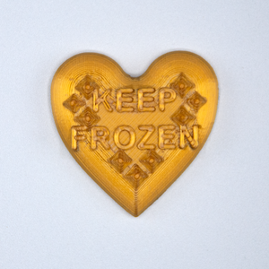 "Gold Candy Heart sticker from Styklet with the text ""Keep Frozen."""