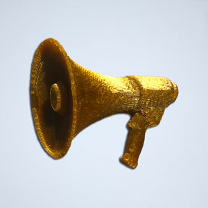 A 3D sticker of a megaphone from Styklet, in a metallic gold color.