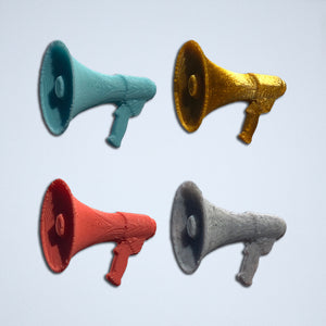 Megaphone 3D stickers from Styklet in turquoise, gold, coral, and gray.
