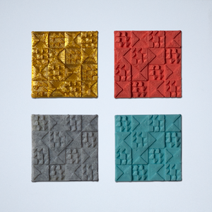 Four texture tile 3D stickers featuring a patchwork quilt inspired pattern, in gold, coral, gray, and turquoise.
