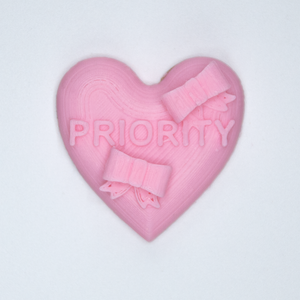 "Pink candy heart sticker from Styklet with the text ""Priority."""
