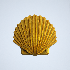 A gold Seashell 3D sticker by Styklet.