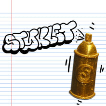 Load image into Gallery viewer, A gold Spray Can Styklet in a graffiti style illustration.