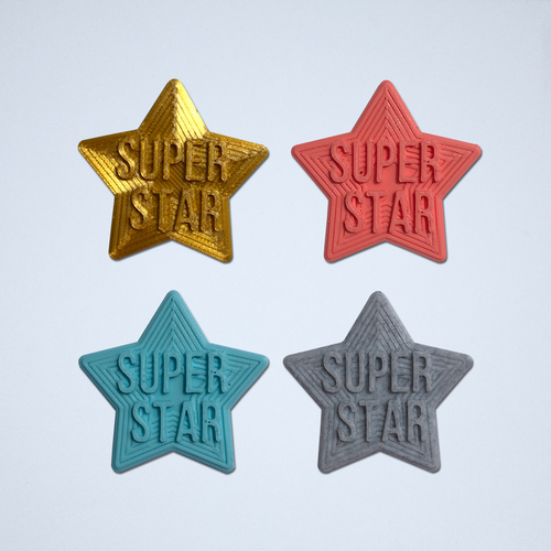 A set of four Super Star 3D stickers in gold, coral, turquoise and gray.