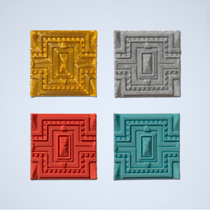 A set of four Tapestry 3D sticker in gold, gray, coral, and turquoise.