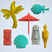 Load image into Gallery viewer, The Tiki Time 3D sticker kit by Styklet, featuring a gold palm tree, a gold tiki torch, a coral drink umbrella, a turquoise pufferfish, a turquoise clam, a gray tiki island head, and a coral tiki totem head.