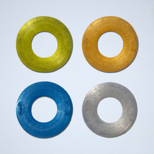 Four inner tube 3D stickers from Styklet, in yellow, orange, blue, and white.