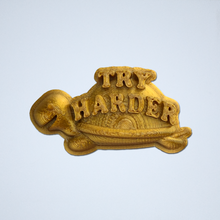 Load image into Gallery viewer, A gold Try Harder 3D sticker by Styklet.