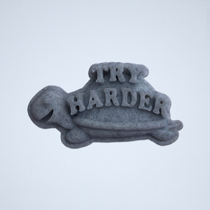 A gray Try Harder 3D sticker by Styklet.