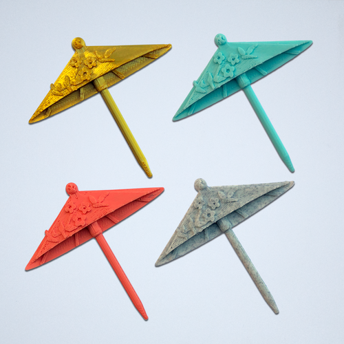 Set of four drink umbrella stickers in gold, turquoise, coral, and grey.