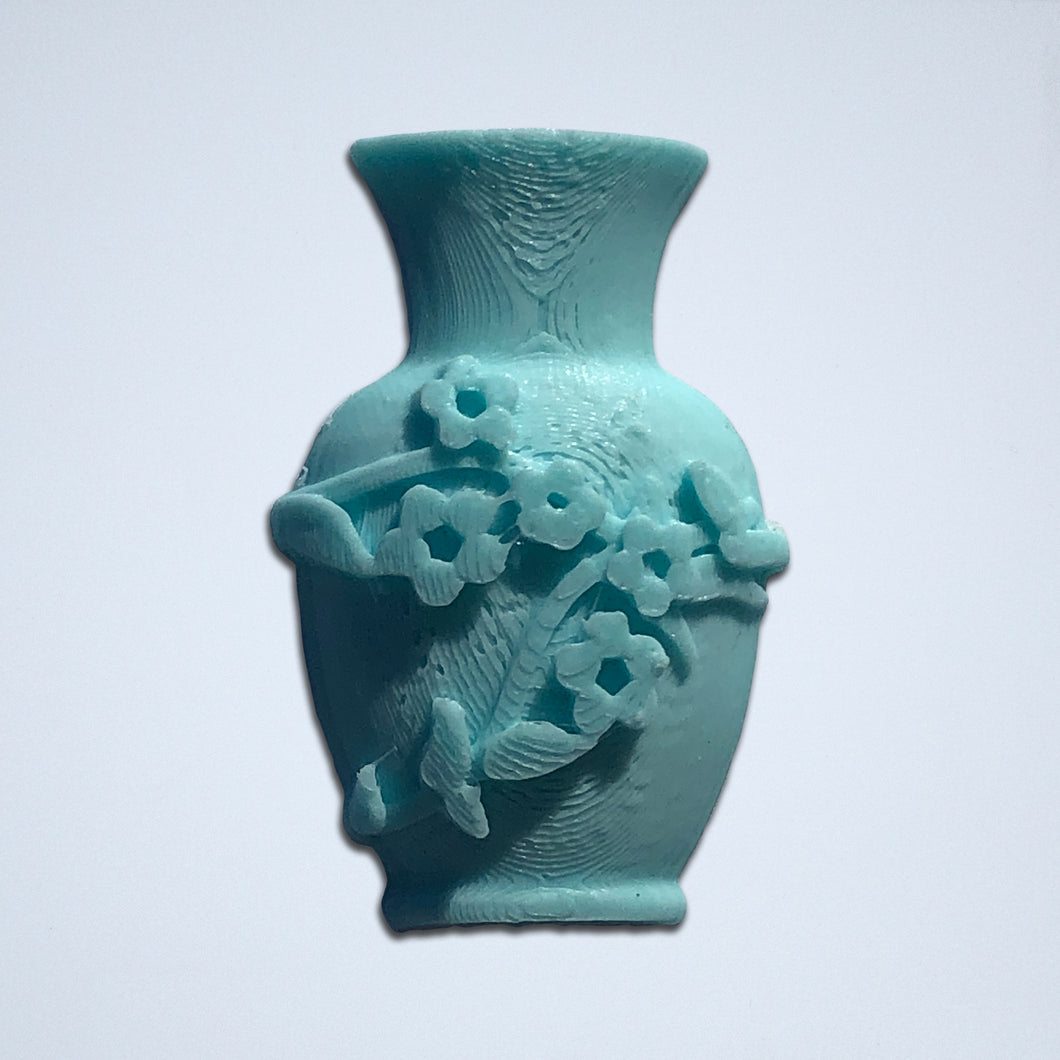 A turquoise floral vase 3D sticker from Styklet.