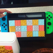 Load image into Gallery viewer, A series of Styklets from the Squares collection featuring a gold Victorian Blossom 3D sticker adorning a nintendo switch.