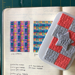 A mini photo printer decorated with patchwork pattern 3D stickers in coral and gray.